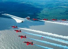 British Airline's Concorde with the Red Arrows on final flight into London Heathrow Airport