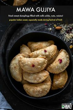 Fried sweet dumplings filled with thickened milk (mawa), nuts, coconut & raisins. Gujiya is traditionally made in Northern India during the festival of colors, Holi! Holi Recipes, Indian Food Recipes, Vegetarian Recipes, Snack Recipes, Dessert Recipes, Desserts, Baking Recipes, Breakfast Recipes, Snacks