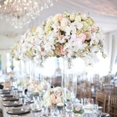 Great color combo.  And similar shape to tall arrangements (your's will be a little smaller and minus the orchids)