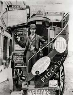 London General Omnibus Corporation horse bus conductor standing on the boarding platform of the bus, 1905