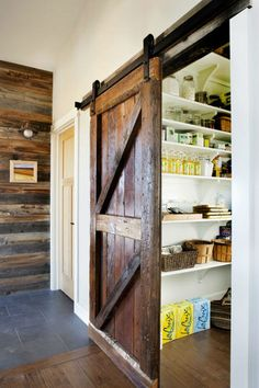 Rustic sliding barn door is a beautiful way to close off the pantry from the kitchen