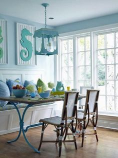 A light blue color palette gives the sense of an ocean breeze in this laid-back eating nook. Seahorse artwork, made of beadboard, brings a nautical touch, while the curves of the table legs mimic ocean waves. Design by Lynn Morgan