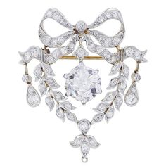 Antique 2.55 Carat Cushion Cut Diamond Gold Platinum Brooch Pin | From a unique collection of vintage brooches at https://www.1stdibs.com/jewelry/brooches/brooches/