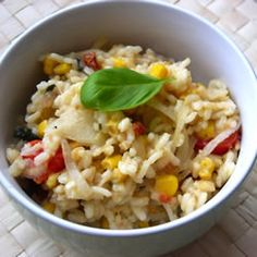 Risotto with Tomato, Corn and Basil Allrecipes.com.... Make it with chicken broth instead of water and we add cream corn along with the fresh corn! Fresh and delicious.... even my picky eater requests this for dinner all the time!!!
