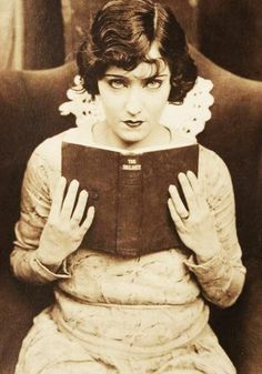 Vintage picture of lady with book.
