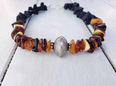 Black Lava Rock and Golden Amber by SunSanJewelry on Etsy
