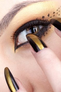 Image detail for -Cat eye woman with black and gold nails | Makeup Gallery