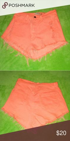 """Coral Jean Shorts Coral orange frayed jean shorts * Size M * Brand """"Vibrant Miu"""" * In excellent condition * 72% cotton. 15% rayon. 12% polyester. 1% spandex. * Made in USA * Offers accepted! Vibrant Shorts Jean Shorts"""
