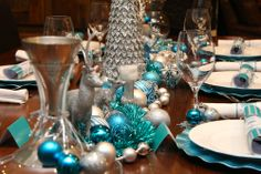 We hope you enjoy our crisp blue and sliver christmas table design