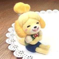 Preview of new tutorial coming tomorrow . The fabulously cute Isabelle from #AnimalCrossing #NewLeaf. This is part of a Nintendo 3DS collab with @nerdecrafter so be sure to check out her video which I will link on Youtube as well. In other news, all the Xmas giveaway prizes have been shipped today! So if you were one of the winners, please keep an eye out for that in the next few weeks. #acnl #kawaii #isabelle #mariokart #geekcrafts #gamecrafts #videogame #felting #needlefelt #poodle…