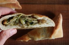 Zucchini, caramelized onions and pine nuts pita triangles.