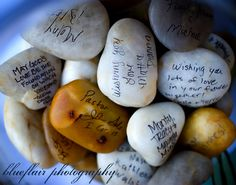 This was one of the coolest (and most original) ideas we've seen all year, and others seem to think so too!  For this wedding, the bride and groom used smooth, flat stones and a sharpie for guests to sign the stones.  SO – instead of a regular guestbook, guests could sign, write messages and well-wishes on the rocks, which were then saved in a hurricane jar.
