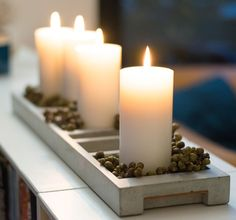 Christmas candles in long concrete tray
