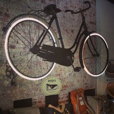 Our ancient Scandinavian bicycle fitted w/ neon wheels