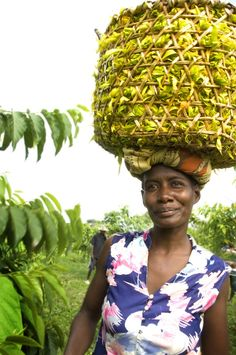 Woman seller carrying a basket of Ylang Ylang flowers in Madagascar