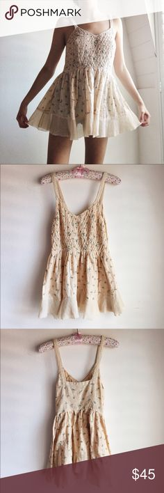 Free People Babydoll One of my favorite free people tops Delicate light peach babydoll top with pink and baby blue flowers. Zips up on the side. Size 4, I'm usually a 0 or 2 and it's almost long enough to wear as a dress on me. Gently worn, no flaws. Free People Dresses Mini