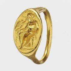 Finger ring engraved with a seated woman and flying Eros, second half of 5th century B.C.  Greek  Gold