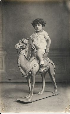 Little prince, cute boy, toy sit on camel, studio portrait, Edwardian child, Spanish Empire, social history, collectible photo (rppc/ch47)