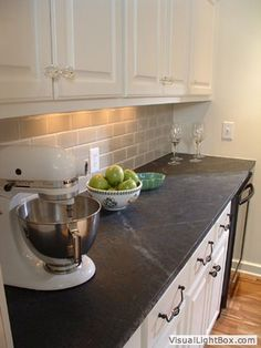 White cabinets with crystal pulls on top Like the dark counters and subway tile backsplash Kitchen Design Trends www.OakvilleRealEstateOnline.com