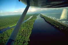 Tortuguero, Limon, Costa Rica. This small town lies on the strip of land between the canals and the Caribbean Sea. It is world renown for its Sea Turtle nesting grounds. I must add, there is nothing quite like taking off in a light aircraft, from a tiny runway, in the pouring rain, while being attacked by fire ants.