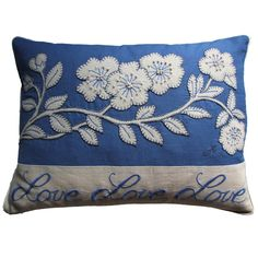 This beautiful, striking cushion combines the intricate detail of the blossom and the instantly recognised Constantine script 'Love, Love, Love'. The blossom is hand appliqued in cream wool onto china blue linen and the details are stitched in blanket and French knots. Jan Constantine  - Love Blossom Cushion JR529, £72.00 (http://www.janconstantine.com/love-blossom-cushion-jr529/)