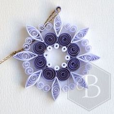 Quilled circle snowflake Christmas ornament by TheBeehiveHandmade