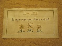 """Smile"" designed and stitched by Yesterday Once More Primitives."