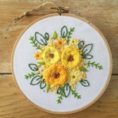 I love all the bright yellow flowers in this design. So cheerful. #flowerembroidery