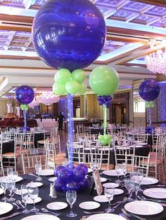Balloon Centerpieces add feathers to bottom or bottom is feather ball or fan