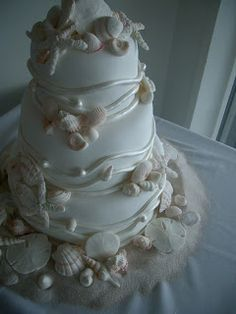 wedding cake with shells. It would be neat to sprinkle brown sugar around the bottom of the cake to resemble sand!