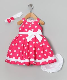 Complete with a lacy headband, silky-soft diaper cover and fancy frock that snaps in back, this charming ensemble makes getting dressed oh-so easy. Tulle in the lining gives this pretty polka dot piece extra pouf.Includes headband, dress and diaper cover100% polyesterMachine washMade ...