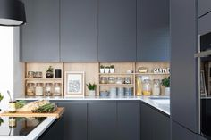 Stunning modern handleless kitchen mixing dark grey and wood effect cabinets. Pictured H Line Sutton in Graphite with Portland Oak Cabinets. Photographed by Paul Craig Grey Kitchen Diner, Dark Grey Kitchen Cabinets, Modern Grey Kitchen, Cottage Kitchen Cabinets, Handleless Kitchen, Grey Kitchen Designs, Contemporary Kitchen Cabinets, Best Kitchen Cabinets, Grey Kitchens