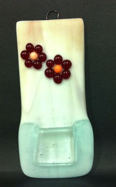 fused glass flower pocket hanging done by a middle school student