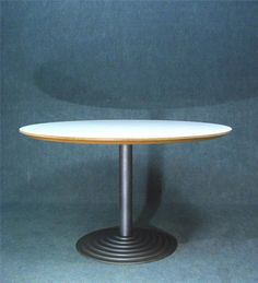 """A wonderful vintage Danish Tulip style dining table  Seats up to 8  Cast iron stepped base, making the table incredibly solid,stable and stylish  The table combines great design and quality construction  Superb one inch birch ply round top with light grey formica surface  Label to underside reads """"Brodrene Sandersen mobelsnedkeri made in Denmark   www.antiques-online.org"""