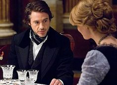 Holmes deduces interesting things about Watson's fiancee, Mary Morstan.  (Robert Downey Jr. as Sherlock Holmes, Kelly Reilly as Mary)