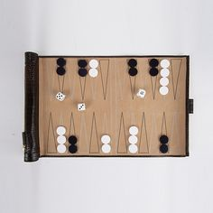 Smythson Travel Backgammon Set. Calf leather with nubuck playing field. Rolls up into itself for travel. €470