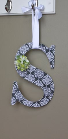 I did this to hang on my wreath hanger. I think it looks good except with the letter M