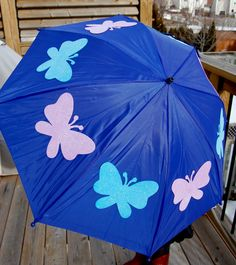 DIY umbrella Perfect for the little ladies, this updated umbrella gets a dose of glitter butterflies made using dollar store glitter foam butterfly cut-outs and Fabri-Tac, a permanent fabric adhesive.