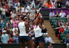 Venus Williams, left, and Serena Williams, right, celebrate after winning the gold.