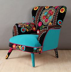 Retro style handmade armchair upholstered with Suzani and velvet fabrics. Beautiful combination of lovely colors. Seat and outer parts are