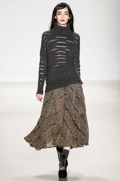 Grey sweater with metallic slits paired with handloom patterned skirt by @Nanette Lepore. #IStyleNY #Style