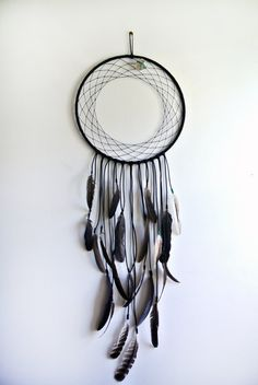4' long dream catcher with cruelty free feathers and a quartz crystal, so simple and elegant!