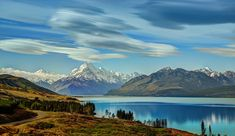 These lenticular clouds are pretty rare — but not on the South Island of New Zealand! This is called the land of the long white cloud… Lake Pukaki, New Zealand - Photo from #treyratcliff Trey Ratcliff at http://www.StuckInCustoms.com