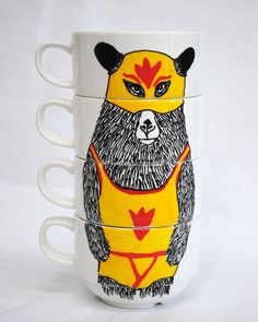 buy plain mugs that stack like this and draw on them with sharpies then put them in the oven!