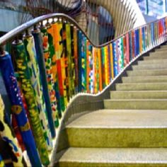 """The rainbow staircase @ City Museum-St. Louis- So if your kid falls down the stairs, the spinning """"re-purposed"""" and decorated conveyer belt rollers will help to propel them to the bottom of the stairs. St Louis City Museum, Instalation Art, Large Scale Art, Rainbow Art, Best Vacations, Visual Merchandising, Stairways, Wedding Pictures, Adventure Travel"""