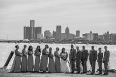 Bridal party stands on Detroit riverbank #Michiganwedding #Michiganwedding #Chicagowedding #MikeStaffProductions #wedding #reception #weddingphotography #weddingdj #weddingvideography #wedding #photos #wedding #pictures #ideas #planning #DJ #photography #bride #groom