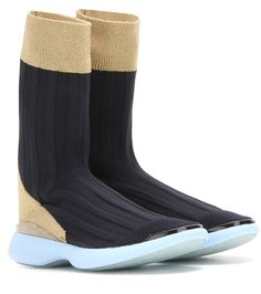 Acne Studios - Batilda sock sneakers - Acne Studios channels a signature streamlined aesthetic with the futuristic Batilda style. Hugging the foot for a sock-inspired look that's finished off with a mesh toe, the black pair is as functional as it is cool. We're teaming ours with a maxi dress for a contemporary pairing. seen @ www.mytheresa.com