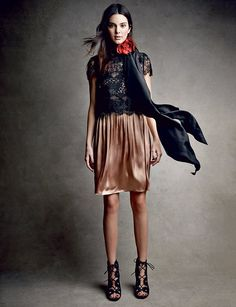 After Hours - Lightweight satin and filigree lace signal the rise of a softer, more feminine kind of evening cool. Lanvin dress and silk scarf with rosette; Lanvin, NYC. Tabitha Simmons sandals with scallop detail.
