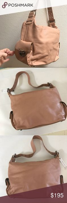 """Gorgeous NWT Marc Jacobs purse This color is really more of tan but with pink/ blush undertones. First photo is in bright natural light and the rest are in a dim natural light. Never worn and bought from the Marc Jacobs store in NYC. My mom gifted me this new I just never used it. Comes with original dust bag. 13"""" W x 11 H Marc Jacobs Bags Shoulder Bags"""