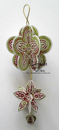 Christmas ornament decoration using Stampin Up Triple Treat Flower stamp, fancy flower punch, five petal flower punch and circle punch. (retired)